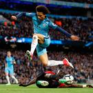 On the slide: Eric Bailly goes to ground to deny Leroy Sane