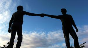 Maurice Harron's Hands Across the Divide Sculpture at the end of the Craigavon Bridge in Londonderry. Picture Martin McKeown.