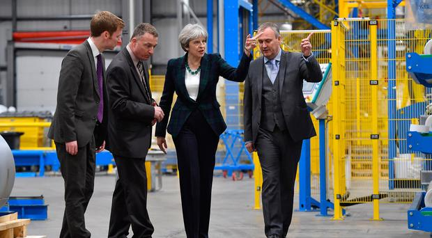 Prime Minister Theresa May speaks with Lee Rowley, Conservative Candidate for North East Derbyshire (L), Andrew McArthur, Engineering Manager (2nd-L) and Anthony Carlysle, Managing Director (R) during a visit to IKO Polymetric on April 27, 2017 in Chesterfield, United Kingdom. (Photo by Anthony Devlin/Getty Images)