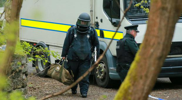 Police and ATO at the scene of a pipe bomb find in Colin Glen Forest Park