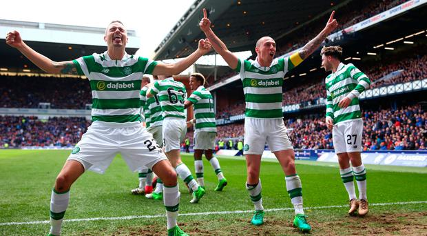Mikael Lustig (L) and Scott Brown of Celtic celebrate their team's third goal scored by Callum McGregor during the Ladbrokes Scottish Premiership match between Rangers and Celtic at Ibrox Stadium on April 29, 2017 in Glasgow, Scotland. (Photo by Michael Steele/Getty Images)