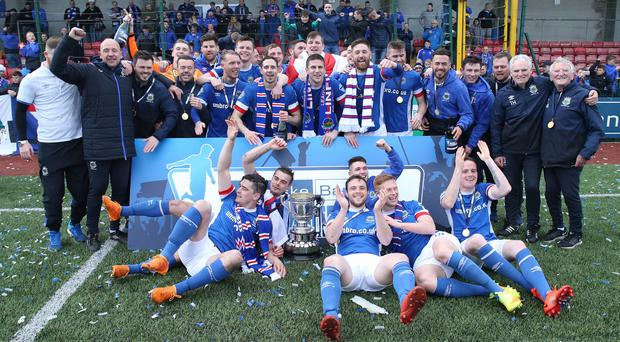 Linfield players celebrate winning the Gibson Cup after defeating Cliftonville at Solitude. Picture by Brian Little/PressEye