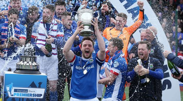 Linfield captain Jamie Mulgrew lifts the Gibson Cup after defeating Cliftonville at Solitude. Picture by Brian Little/PressEye