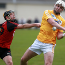 Pressure on: Antrim's Conor McKinley is chased by Down's Scott Nicholson