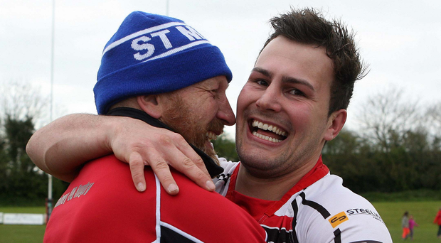 Going up: Rainey Old Boys coach John Andrews and Philip McCusker celebrate