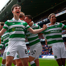 High hoops: Kieran Tierney laps up Celtic's success at Ibrox