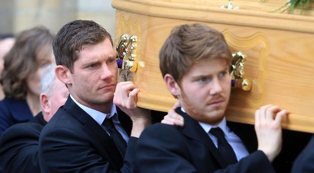 Michael McGovern (left) carries his mother Carmel's coffin with his brother Joseph
