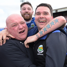 Top dogs: Linfield boss David Healy celebrates with team attendant Gary Eccles and (middle) defender Mark Stafford