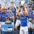 Just champion: Blues skipper Jamie Mulgrew lifts the Gibson Cup