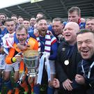 Champion: David Healy and his players celebrating the title, will now turn their attention to the Irish Cup