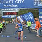 Laura Graham the first lady runner during the Belfast City Marathon on Bank Holiday Monday, with over 15,000 people taking part threw the streets of Belfast, with the Finish line at Ormeau Park. Pic Colm Lenaghan/Pacemaker