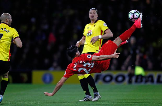 Liverpool's German midfielder Emre Can connects with this overhead kick to open the scoring in the English Premier League football match between Watford and Liverpool at Vicarage Road Stadium in Watford, north of London on May 1, 2017. AFP/Getty Images