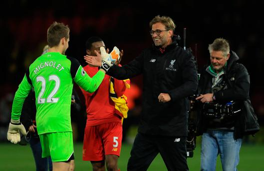 Simon Mignolet of Liverpool and Jurgen Klopp the manager of Liverpool celebrate their team's 1-0 victory during the Premier League match between Watford and Liverpool at Vicarage Road on May 1, 2017 in Watford, England. (Photo by Richard Heathcote/Getty Images)