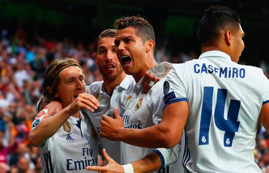 MADRID, SPAIN - MAY 02: Cristiano Ronaldo of Real Madrid (2R) celebrates as he scores their first goal with team mates during the UEFA Champions League semi final first leg match between Real Madrid CF and Club Atletico de Madrid at Estadio Santiago Bernabeu on May 2, 2017 in Madrid, Spain. (Photo by Clive Rose/Getty Images)