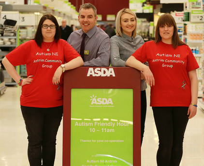 Joe McDonald, Asda's senior manager of corporate affairs NI, with members of Autism NI's Antrim Community Support Group at Asda Antrim's Autism Friendly Hour