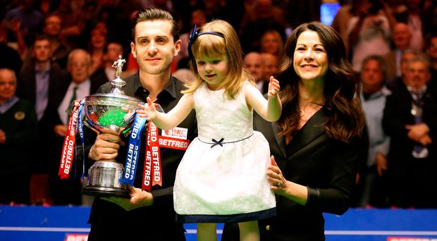 Happy family: Mark Selby celebrates with his daughter Sofia Maria and wife Vikki Layton at the Crucible