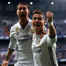 Three and easy: Cristiano Ronaldo celebrates the opening goal of his stunning hat-trick with Sergio Ramos in Real Madrid's 3-0 first leg Champions League semifinal win over Atletico Madrid at the Bernabeu