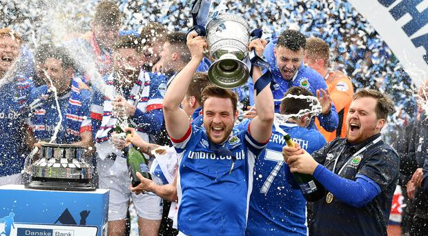 Contrast: While Jamie Mulgrew was celebrating Premiership title success with Linfield on Saturday, brother Ben was part of the Bangor side relegated out of Irish League football