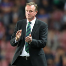 Staying put: Michael O'Neill insists he is committed to helping Northern Ireland reach Russia in 2018