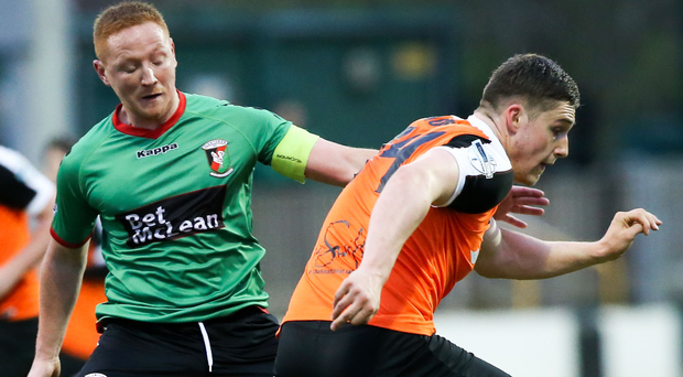 Departure: Midfielder Stephen McAlorum (left) has been released by Glentoran