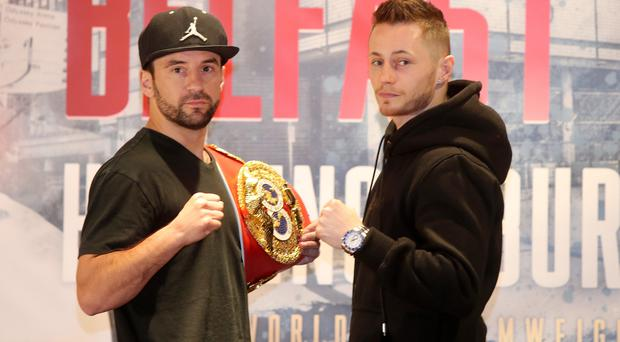 Raring to go: Ryan Burnett (right) and Lee Haskins square up at the Europa Hotel yesterday