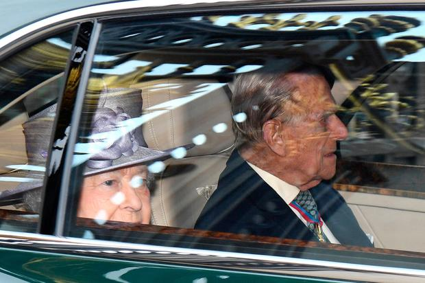 Queen Elizabeth II and Prince Philip, Duke of Edinburgh, wearing his Order of The Merit, depart in their car from Buckingham Palace for a service for members of The Order of The Merit at St James's Palace on May 4, 2017 in London, England.