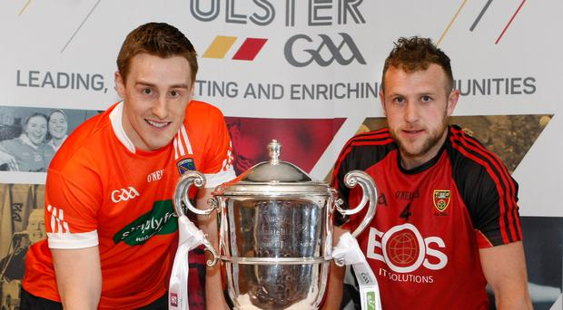 Business as usual: Armagh full-back Charlie Vernon and Down's Darren O'Hagan at last night's Ulster Championship launch