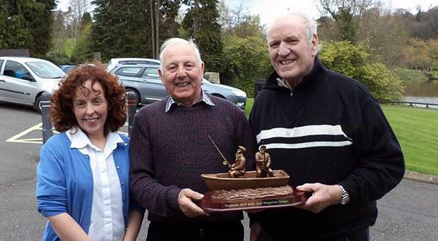 Winning combination: Bronagh Herron of Dungannon Park presents Robert Bell and George Best with the Pairs Trophy