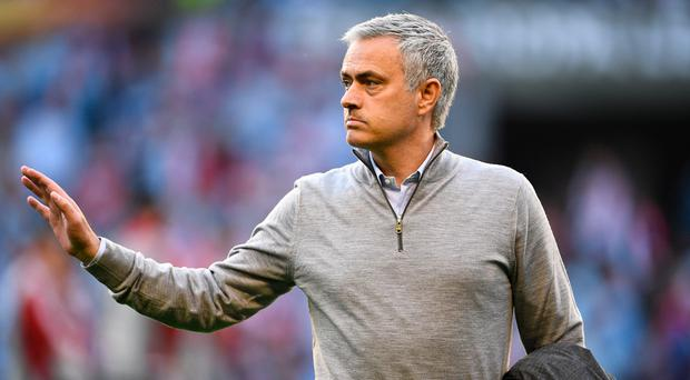 Staying cool: Jose Mourinho will mix up his team, while his bitter rivalry with Arsenal manager Arsene Wenger has ended. Photo: David Ramos/Getty Images