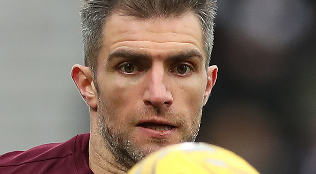 Aaron Hughes signing a new one year contract. with Hearts. Photo: Ian MacNicol/Getty Images