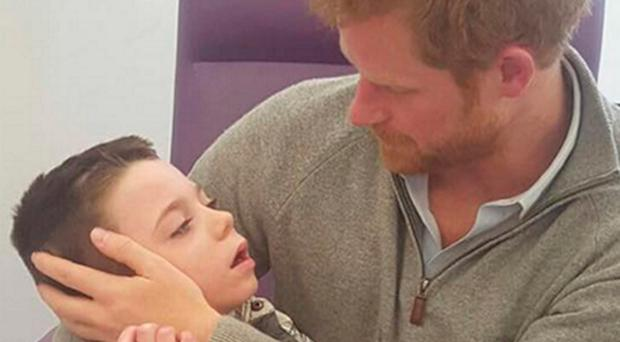 Prince Harry with Ollie Carroll during his private visit to Great Ormond Street Hospital