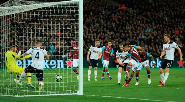 Crucial: Manuel Lanzini fires West Ham's winner against Spurs last night. Photo: Richard Heathcote/Getty Images