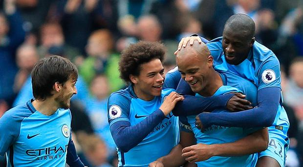Manchester City's Vincent Kompany celebrates scoring his side's second goal of the game during the Premier League match at the Etihad Stadium, Manchester.
