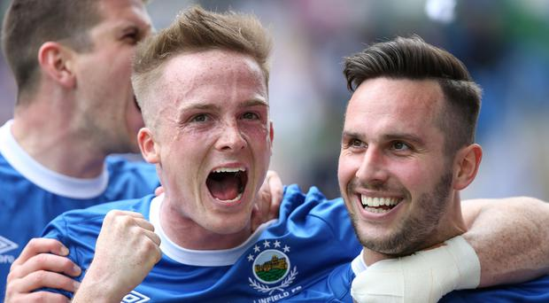 Linfield's Andrew Waterworth celebrates scoring the opening goal against Coleraine during Saturday's Tennent Irish Cup Final at the National Stadium, Windsor Park. Picture by Brian Little/PressEye