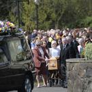 The family of Kevin Carey walk behind his coffin following a funeral mass at St Oliver Plunkett's church Clady. Pic by Peter Morrison