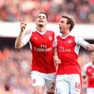 Arsenal's Granit Xhaka (left) celebrates scoring his side's first goal of the game with team-mate Arsenal's Nacho Monreal (right) during the Premier League match at the Emirates Stadium, London.