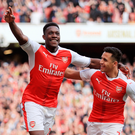 Fire away: Danny Welbeck celebrates with Arsenal teammate Alexis Sanchez after scoring against Manchester United. Photo: Richard Heathcote/Getty Images