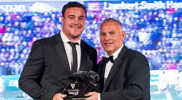 Ru beauty: Ulster's Rob Herrring accepts Ruan Pienaar's Try of the Year award from Tony Ward. Photo: Ryan Byrne/INPHO