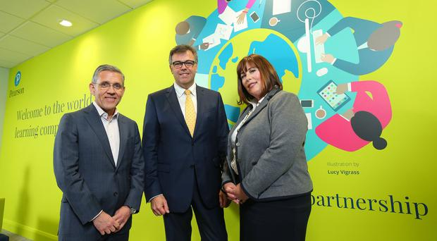 Pearson plc, the world's learning company, has opened a new Finance Services centre in Belfast. Pictured (L – R) are Gareth Morgan, Pearson, Alastair Hamilton, Invest NI CEO and Suzanne Willmott, Director & Centre Lead - Pearson Finance Services. Photo by Kelvin Boyes / Press Eye.
