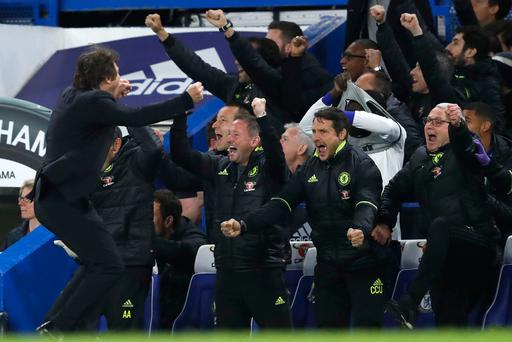 Chelsea's Italian head coach Antonio Conte celebrates Chelsea's third goal during the English Premier League football match between Chelsea and Middlesbrough at Stamford Bridge in London on May 8, 2017. AFP/Getty Images