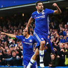 Joy and pain: Diego Costa leaps into the air to hail his opener for Chelsea as dejected Boro players face up to their relegation