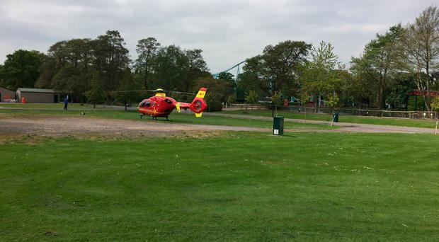 Handout photo taken with permission from the Twitter feed of David Charles @davecharlesF1 of an air ambulance at Drayton Manor Theme Park in Drayton Manor, Tamworth, where the Splash Canyon ride has been closed after reports of someone falling in the water. David Charles/PA Wire