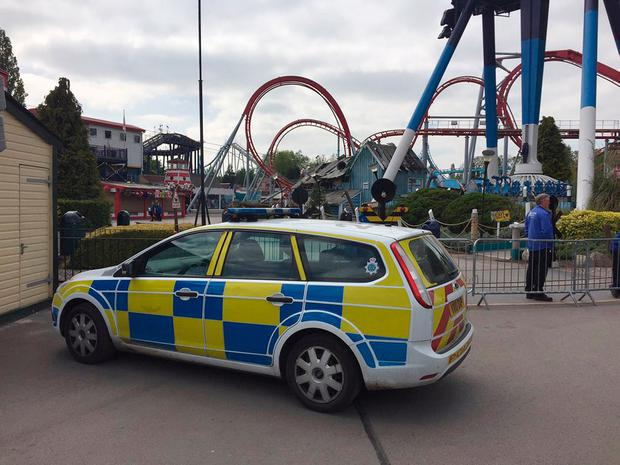 Handout photo taken with permission from the Twitter feed of David Charles @davecharlesF1 of a police vehicle at Drayton Manor Theme Park in Drayton Manor, Tamworth, where the Splash Canyon ride has been closed after reports of someone falling in the water. PA