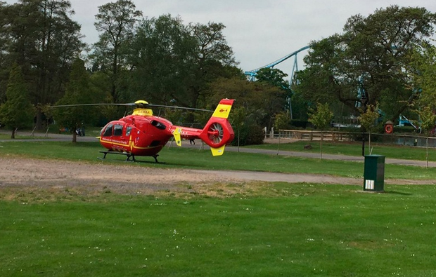 Handout photo taken with permission from the Twitter feed of David Charles @davecharlesF1 of an air ambulance at Drayton Manor Theme Park in Drayton Manor, Tamworth, where the Splash Canyon ride has been closed after reports of someone falling in the water. PA