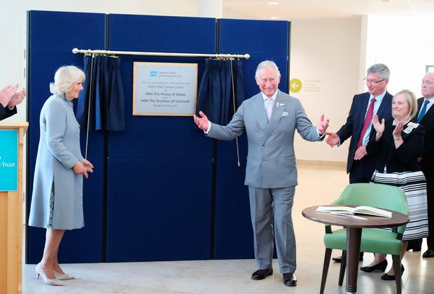 The Prince of Wales and Duchess of Cornwall unveil a plaque at opening of the North West Cancer Centre at Altnagelvin Hospital in Derry during their visit to Northern Ireland. PA