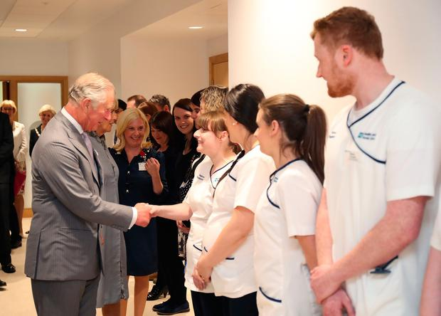 The Prince of Wales meets staff during a tour of the North West Cancer Centre at Altnagelvin Hospital in Derry during their visit to Northern Ireland. PA