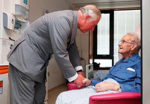 The Prince of Wales meets Robert Mawhinney, during a tour of the North West Cancer Centre at Altnagelvin Hospital in Derry during their visit to Northern Ireland. PA