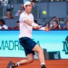 On the march: Andy Murray en route to progressing in Madrid