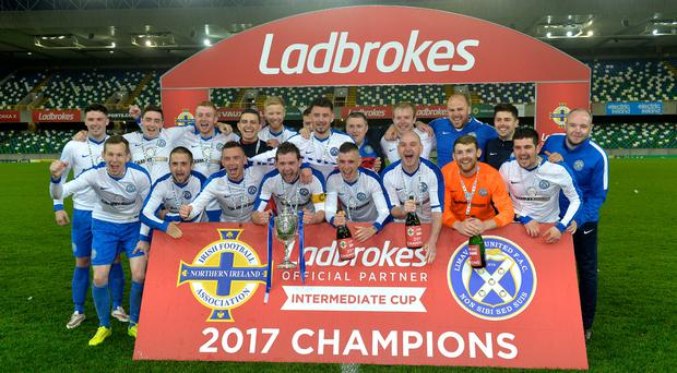 United we stand: Limavady celebrate Intermediate Cup success over Linfield Swifts at Windsor Park last night