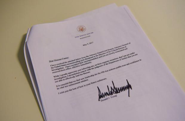 A copy of the termination letter to FBI Director James Comey from US President Donald Trump is seen at the White House on May 9, 2017 in Washington, DC. AFP/Getty Images